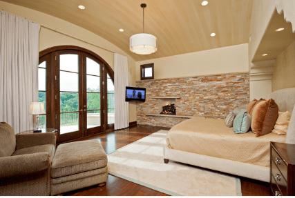 Tuscan Inspired Bedroom by Jenkins Custom Homes.