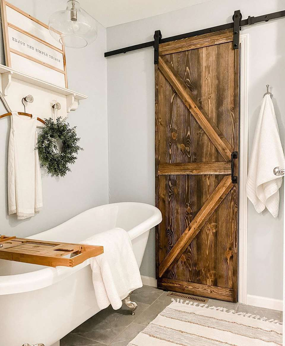 Farmhouse inspired barn door in bathroom