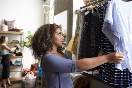 3f83bbf3a31 Woman shopping for clothes. monkeybusinessimages iStock. Most ...