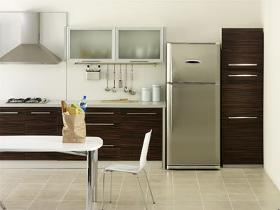 Refrigerator in a nice clean kitchen