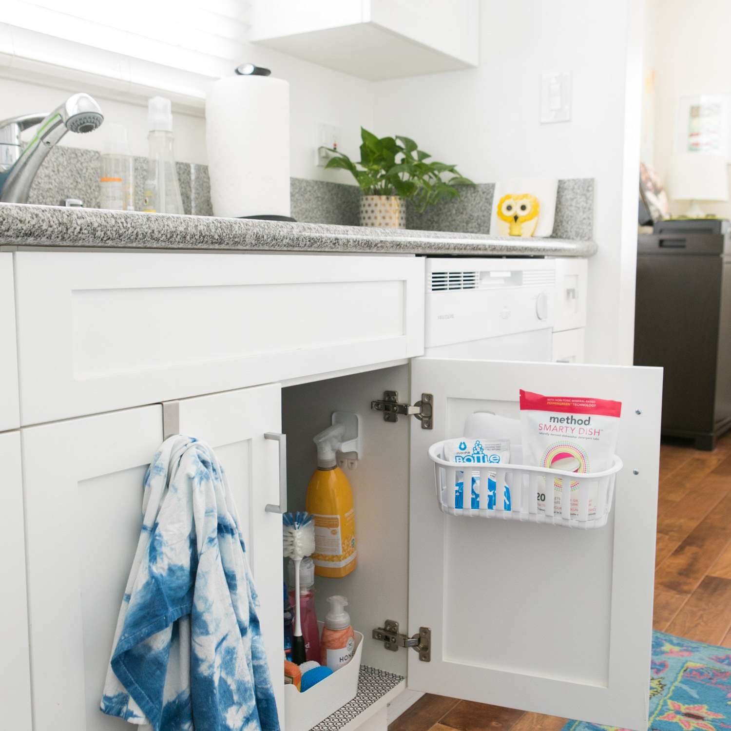 Products stored under a kitchen sink.