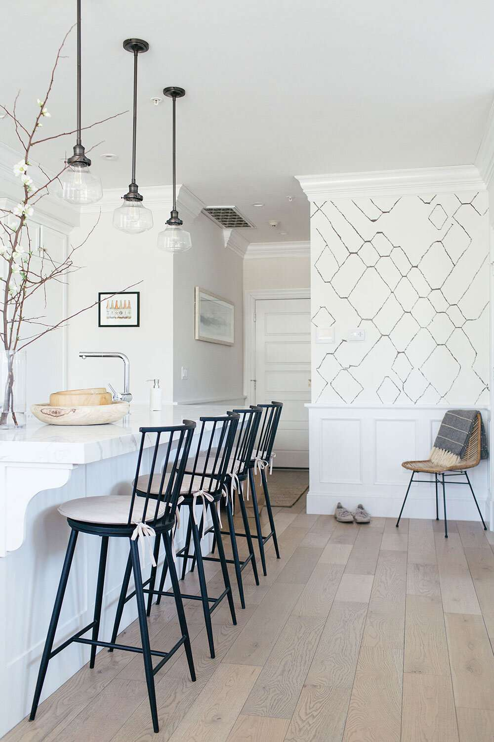 White kitchen with black chairs