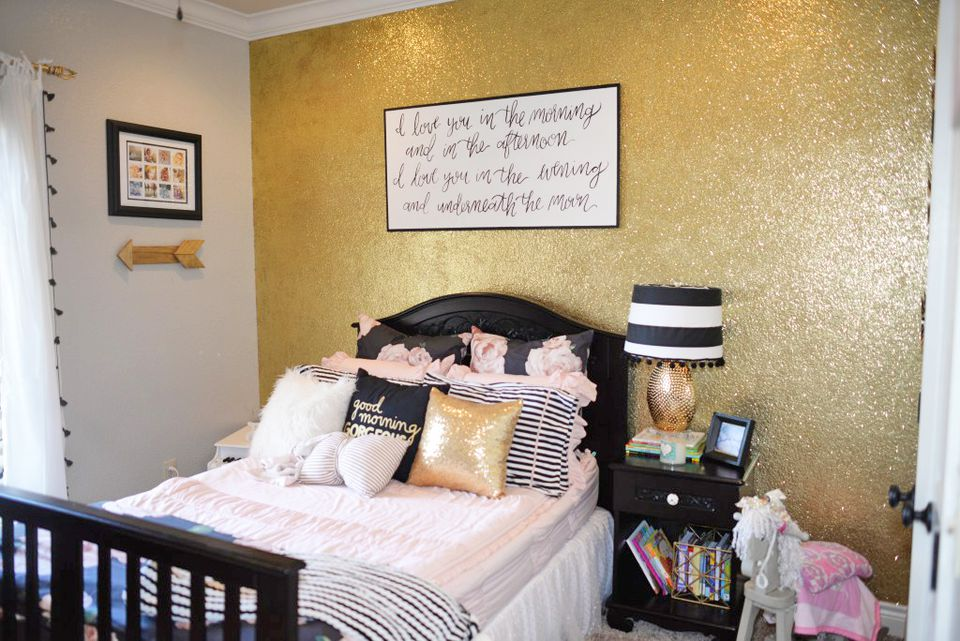 Black, white, and gold girl's room with gold glitter accent wall