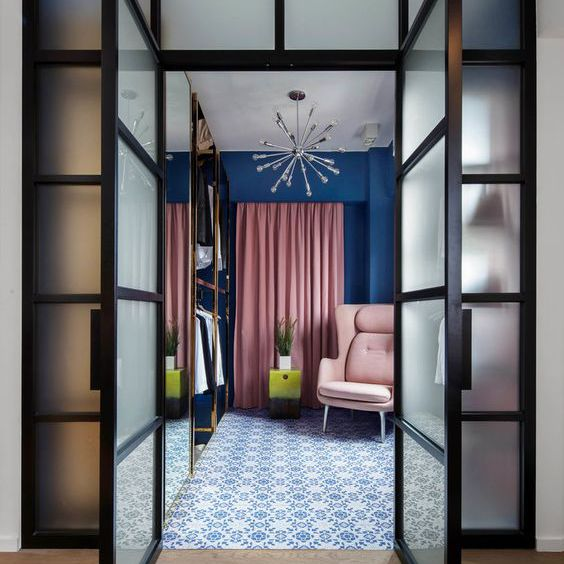 Walk in closet designed in shades of pink and blue