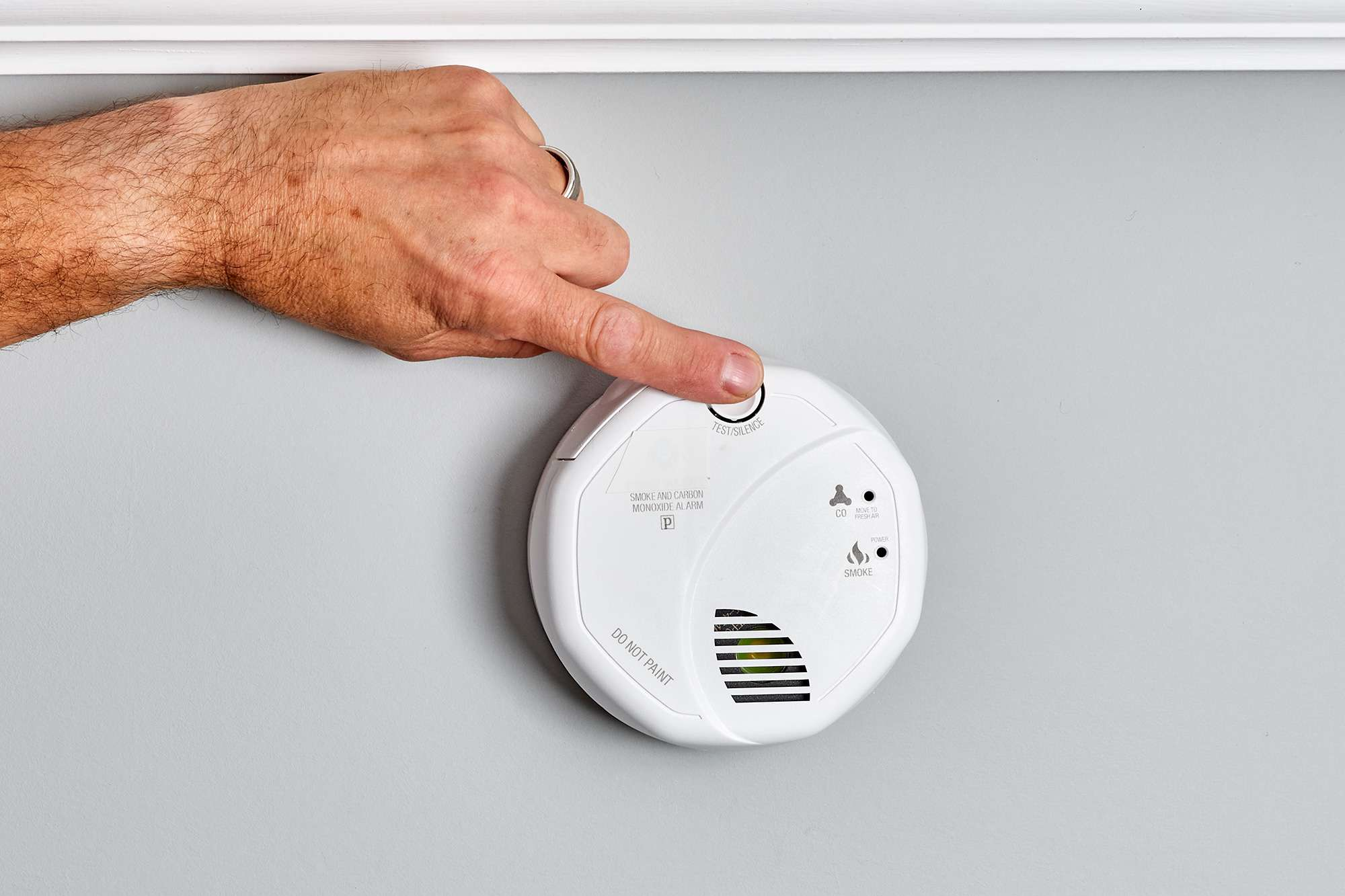 Power button on smoke detector pressed for testing