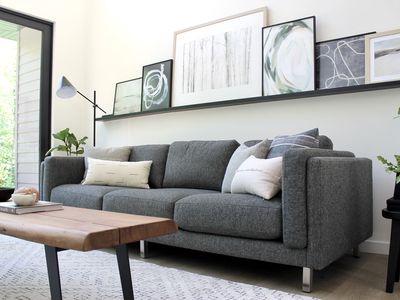 charcoal grey sofa with throw pillows