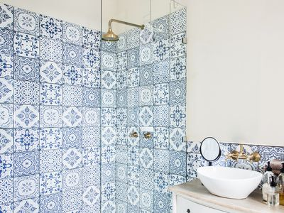 Blue and white patterned tile in bathroom shower