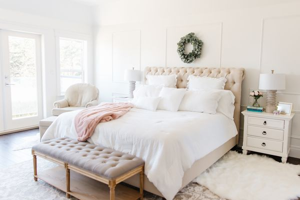 white bedroom tufted bed