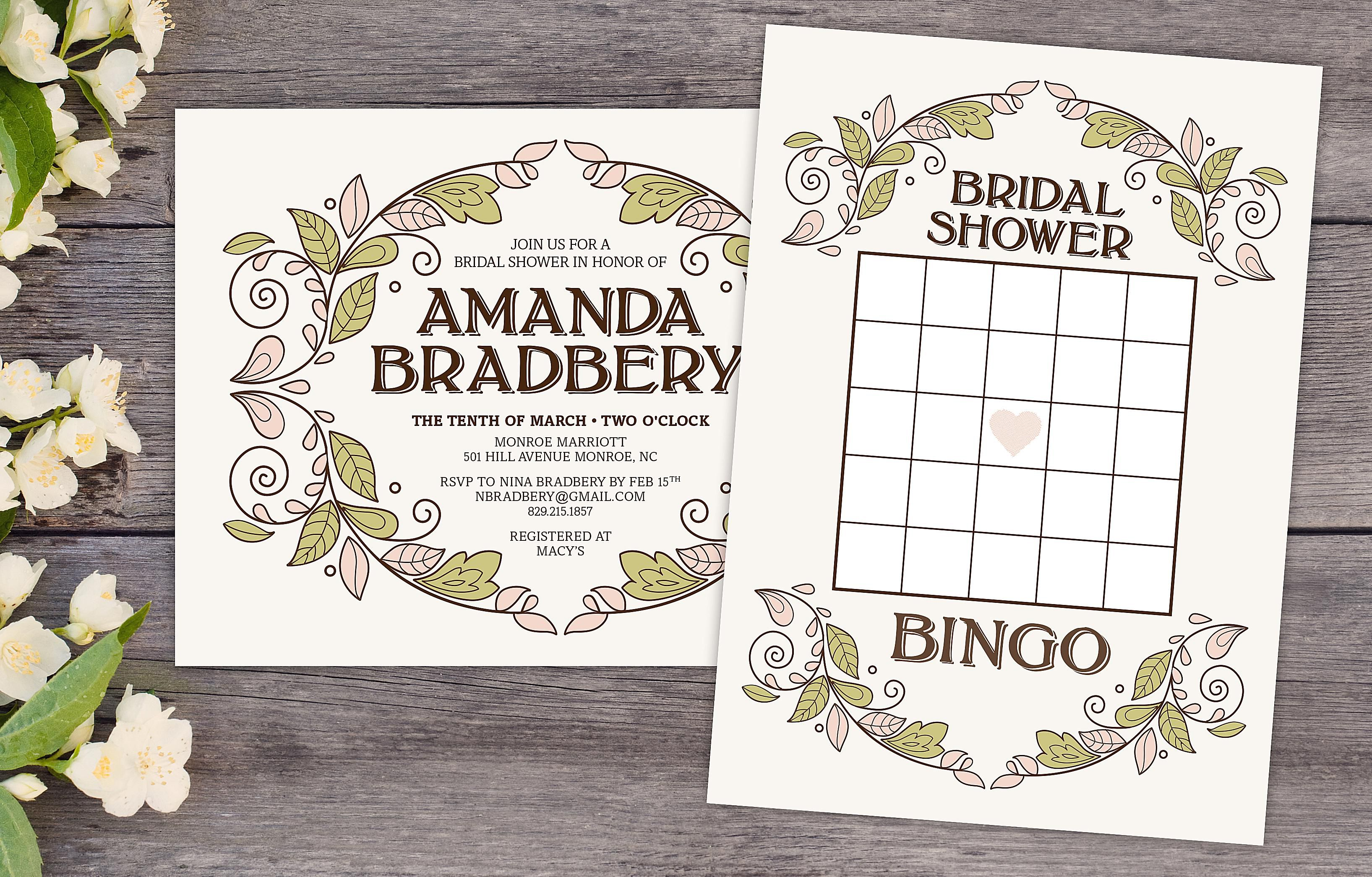 a bridal shower bingo card and bridal shower invitation on a wooden table surrounded by flowers