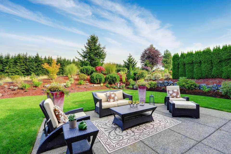 Impressive backyard landscape design with patio area