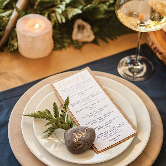 Place setting with rocks and ferns.