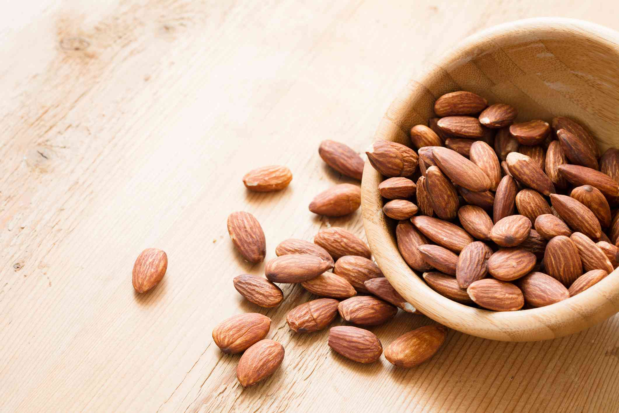 Almonds spilling out of bowl