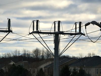 Overhead power lines near residential homes.