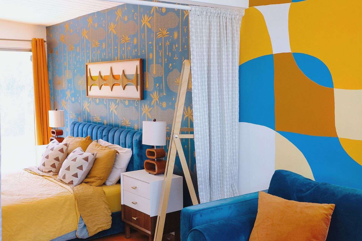 eclectic blue and yellow bedroom with various patterns and designs
