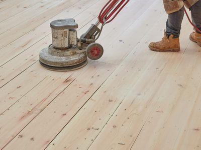 Buffing machine passing over hardwood floor
