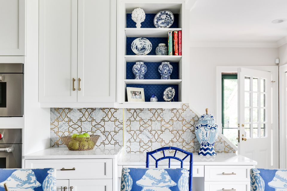 Lori Loomis Kitchen with white cabinets, open shelving, and blue and white porcelain