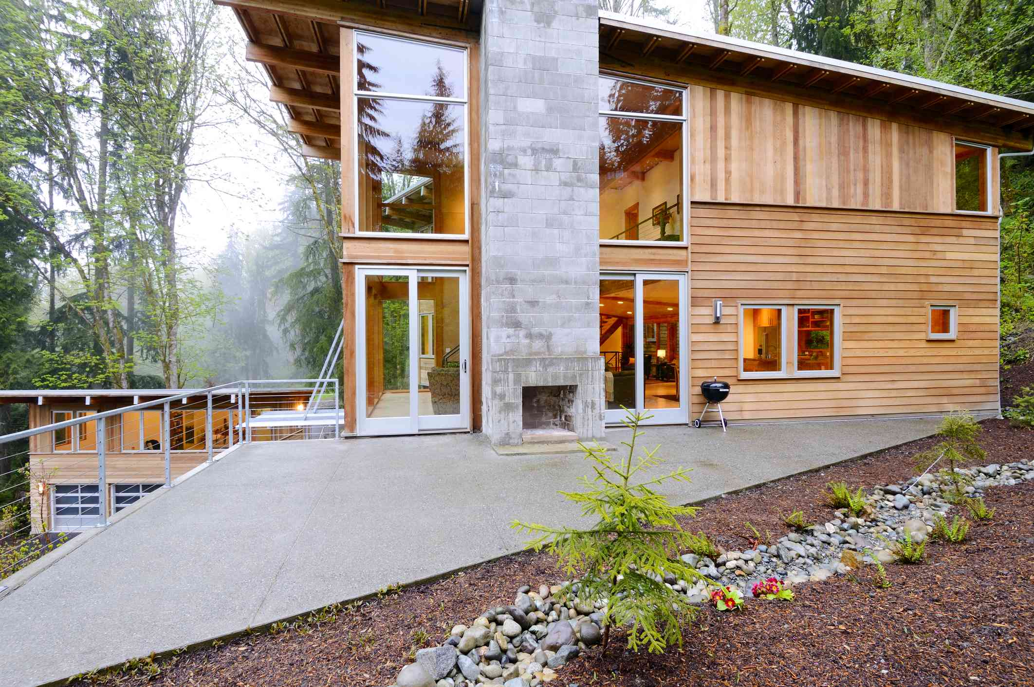 wood-clad contemporary home in a forest setting