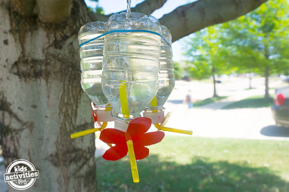 A hummingbird feeder made from a plastic bottle