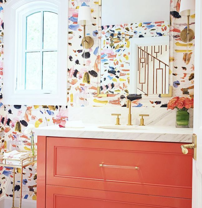 Bathroom with coral dresser