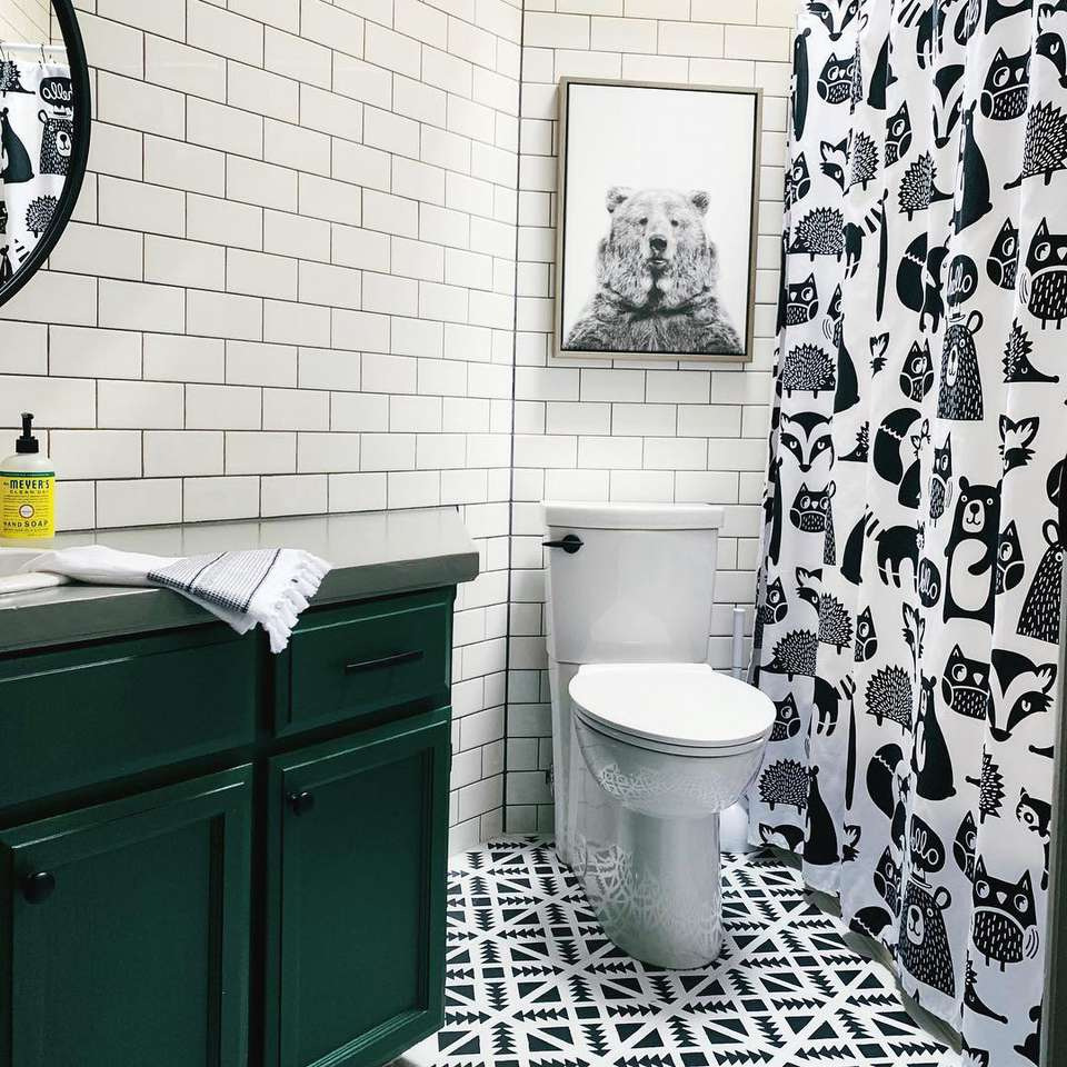 Woodland-themed kids bathroom with graphic black and white prints and patterns