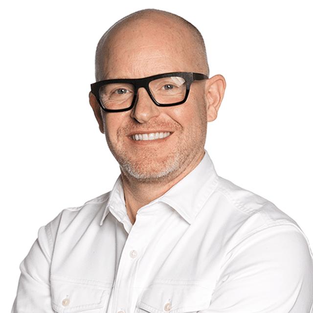 James Brewer, design consultant in white shirt and black-framed glasses