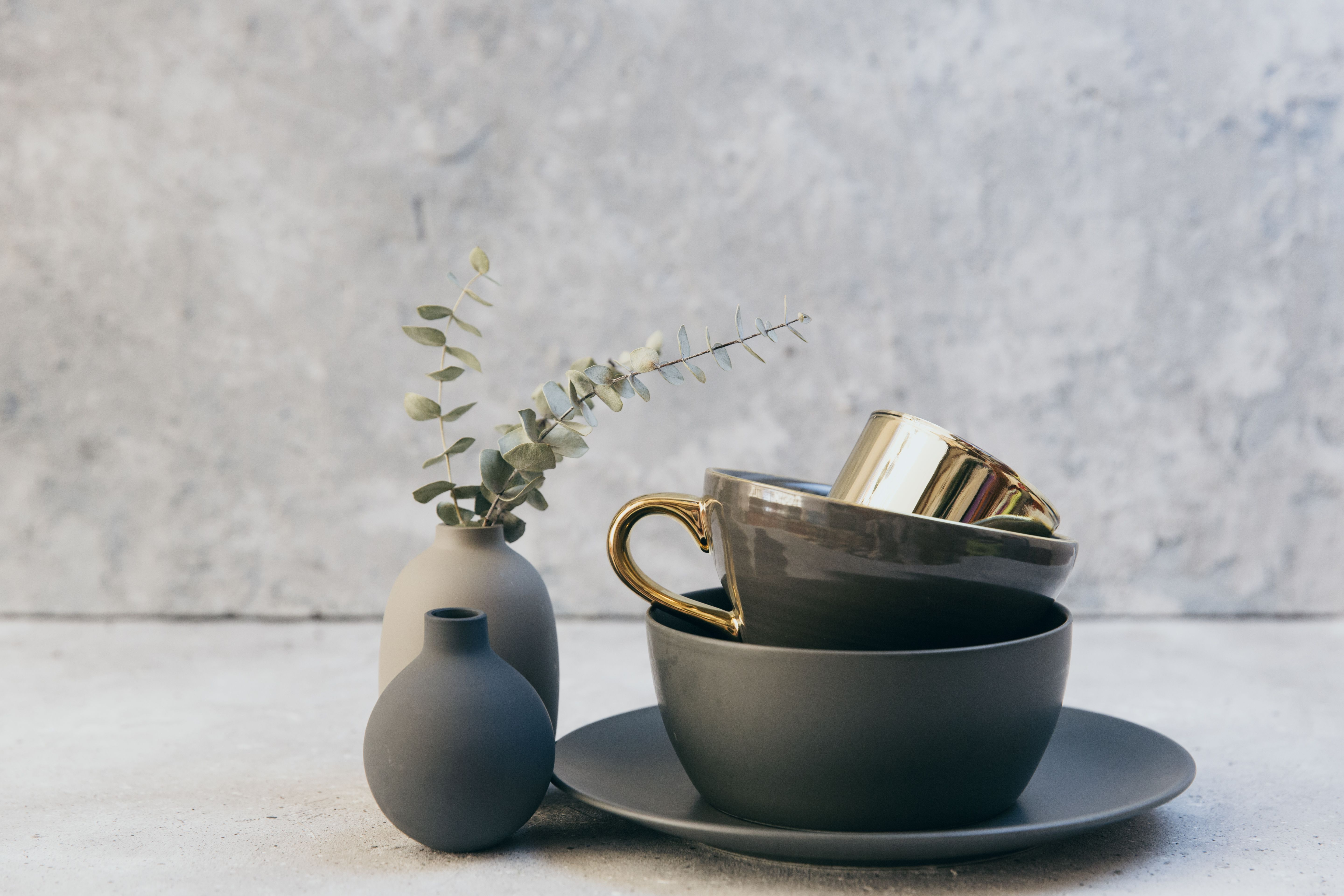 Set of grey crockery in home living room. Nordic decor