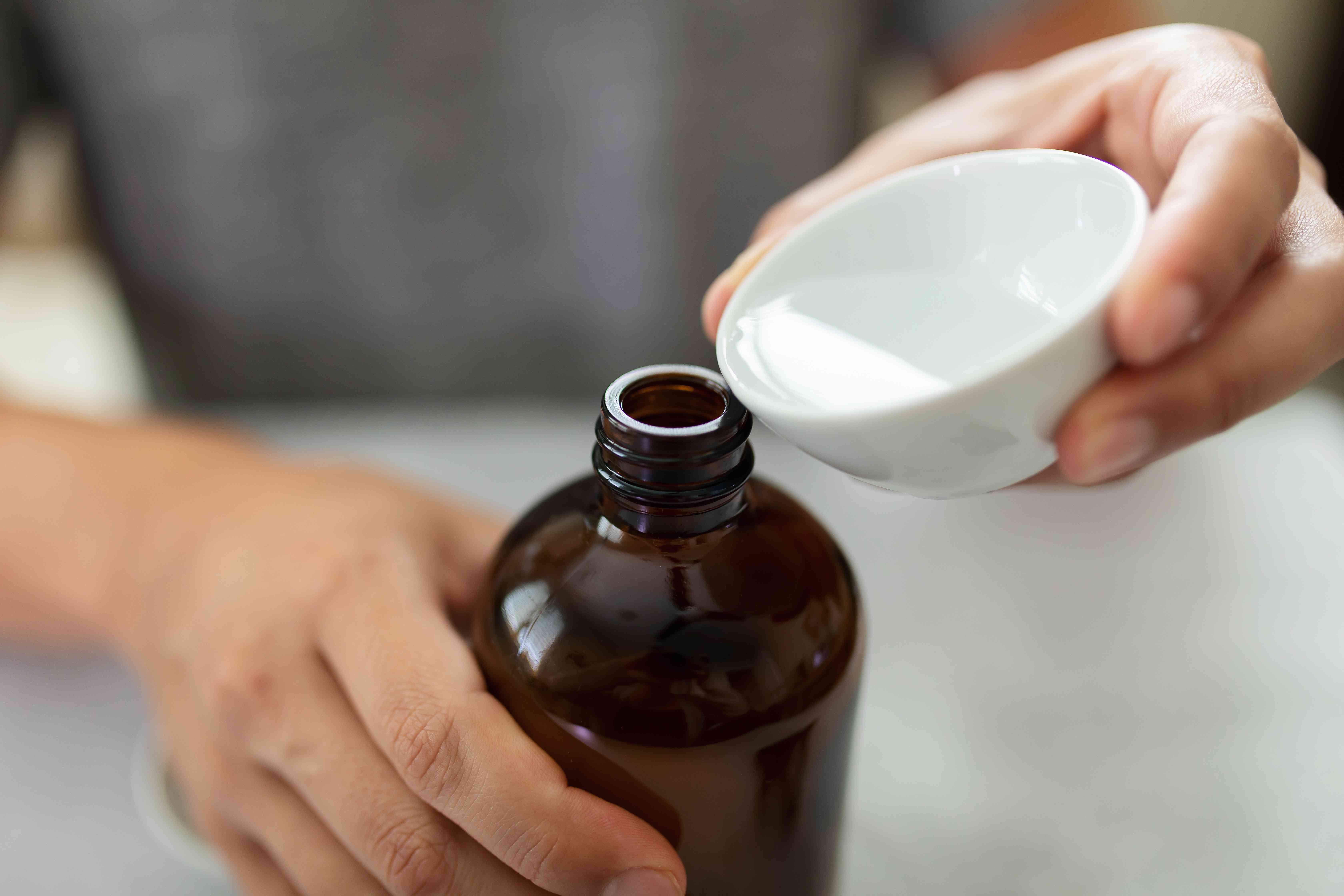 person making a chlorine bleach spray