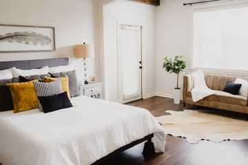bedroom with added seating areas