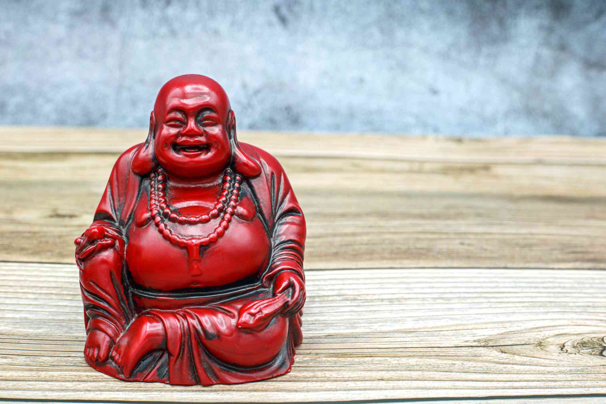 Small figurine of the Laughing Buddha, also called Budai or Maitreya Buddha, a Chinese monk from the 10th century.