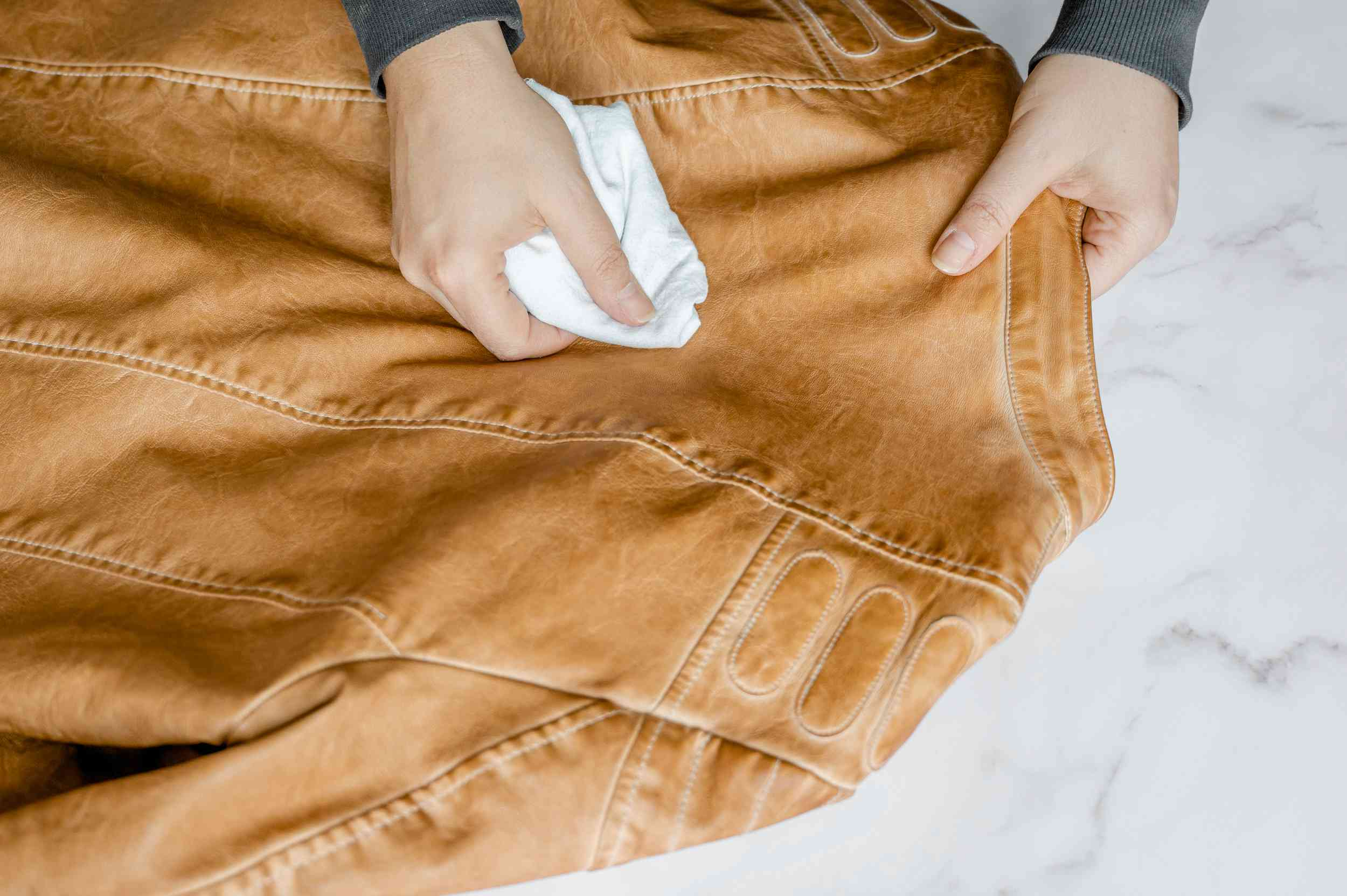 Removing surface stains from leather with a white cloth