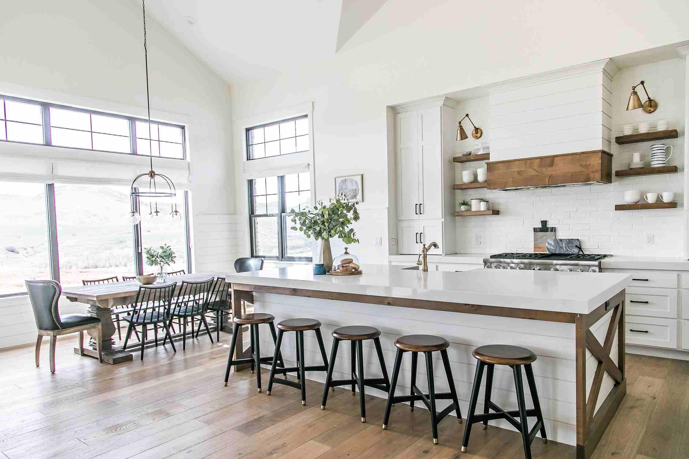 wood paneled kitchen hood brass lighting.jpg
