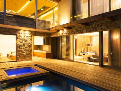 deck with hot tub and pool
