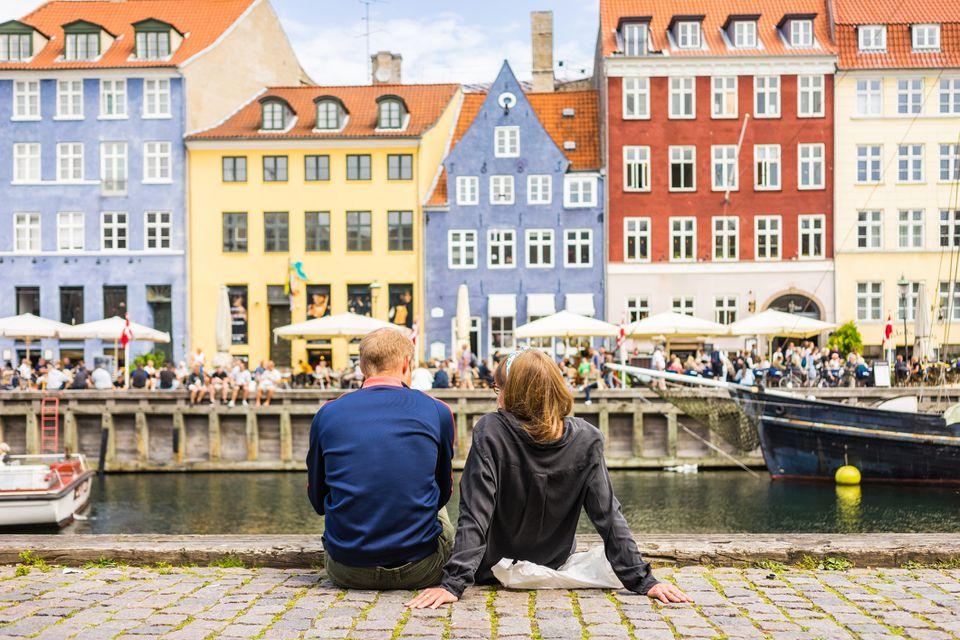 Denmark couple enjoying Nyhavn pier