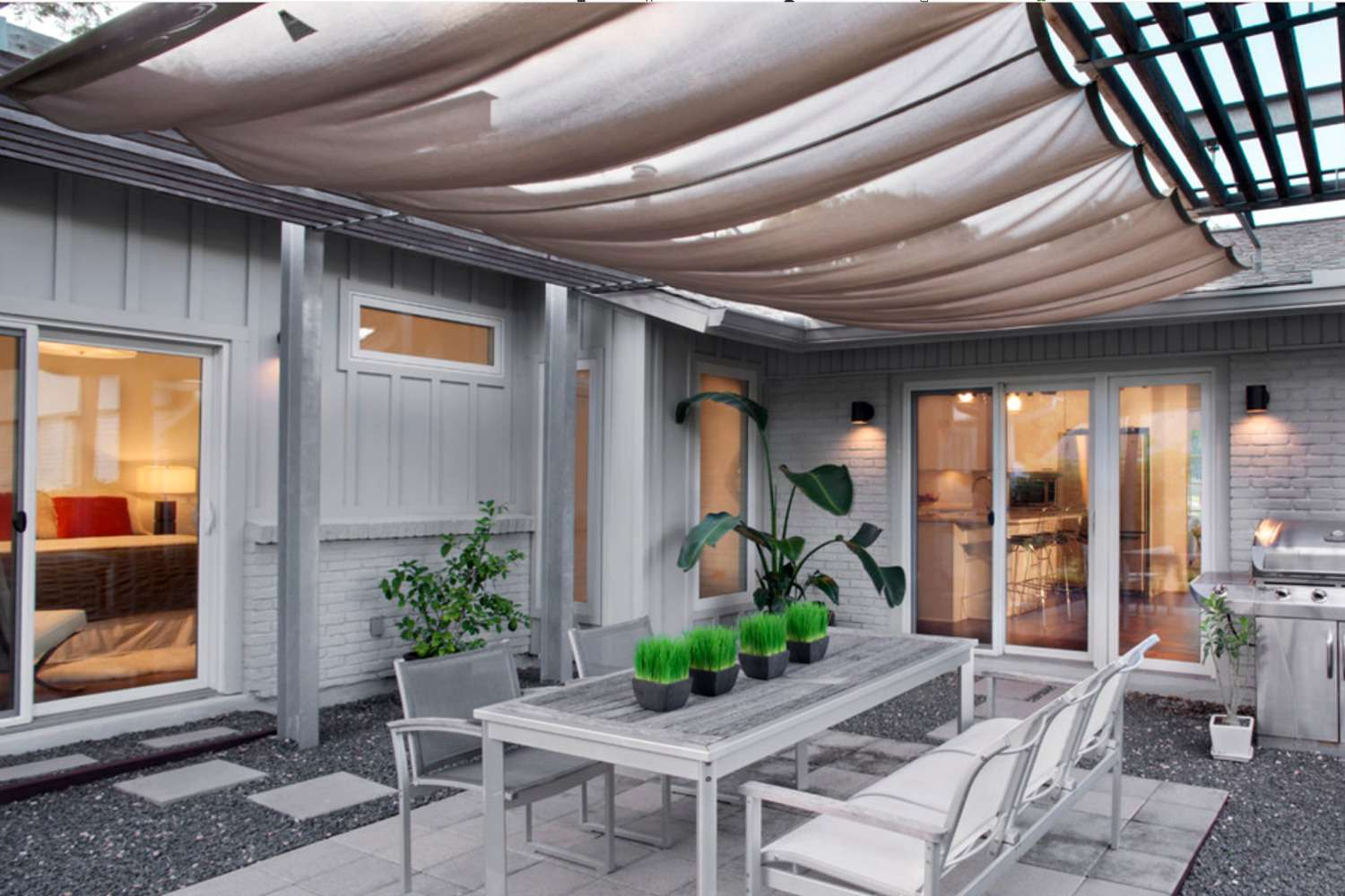 covered patio open weave solar fabric roof and dining room