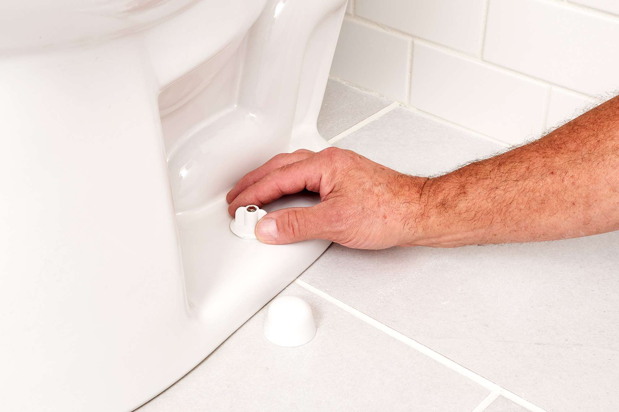 Toilet fittings being check at bottom