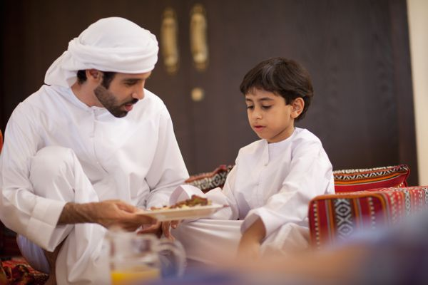 An Middle Eastern Culture family break the fast during Ramadan.