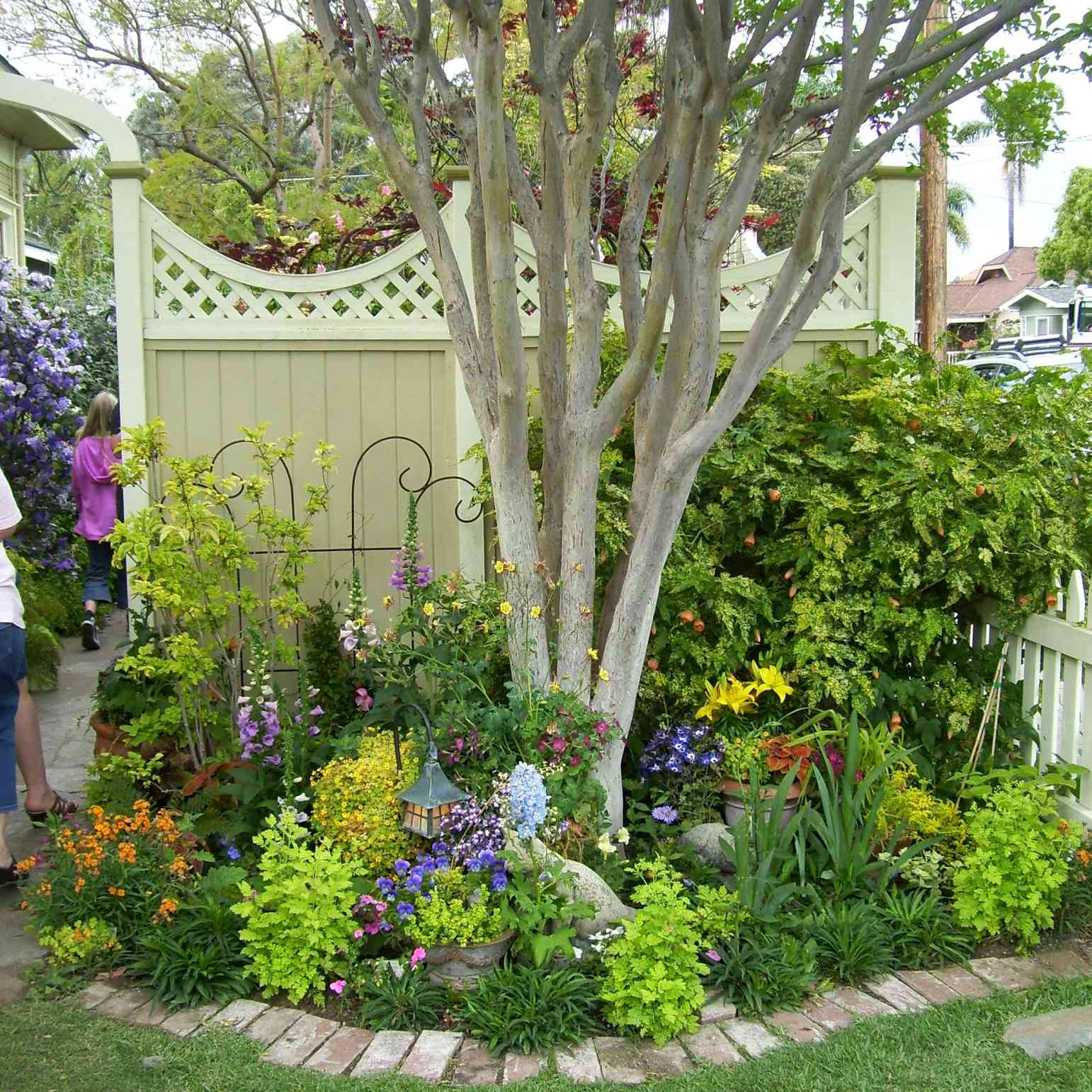 flower beds around trees
