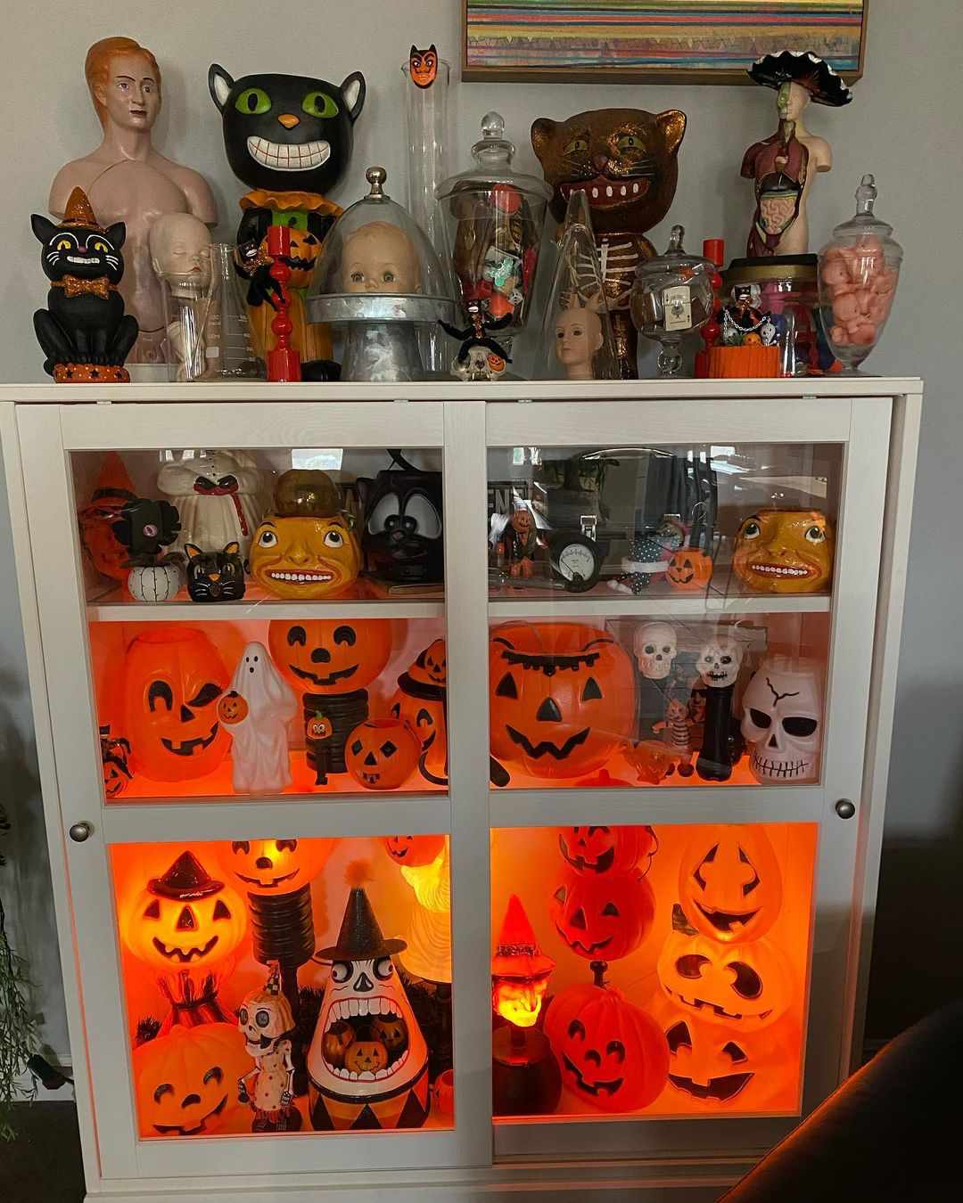 Cabinet display of pumpkins and more.