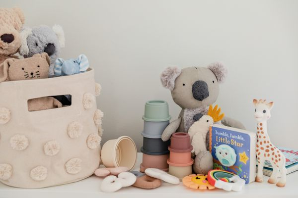 Baby toys for ages six to twelve months stacked next to each other