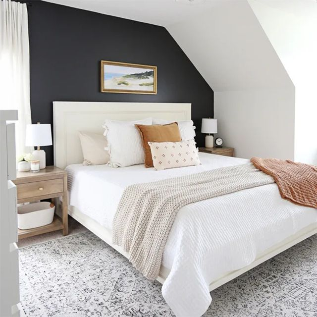 A bedroom with a white bed