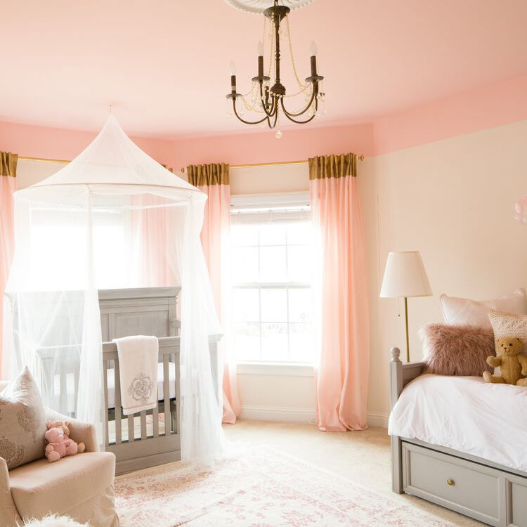 pink and gray nursery with golden chandelier