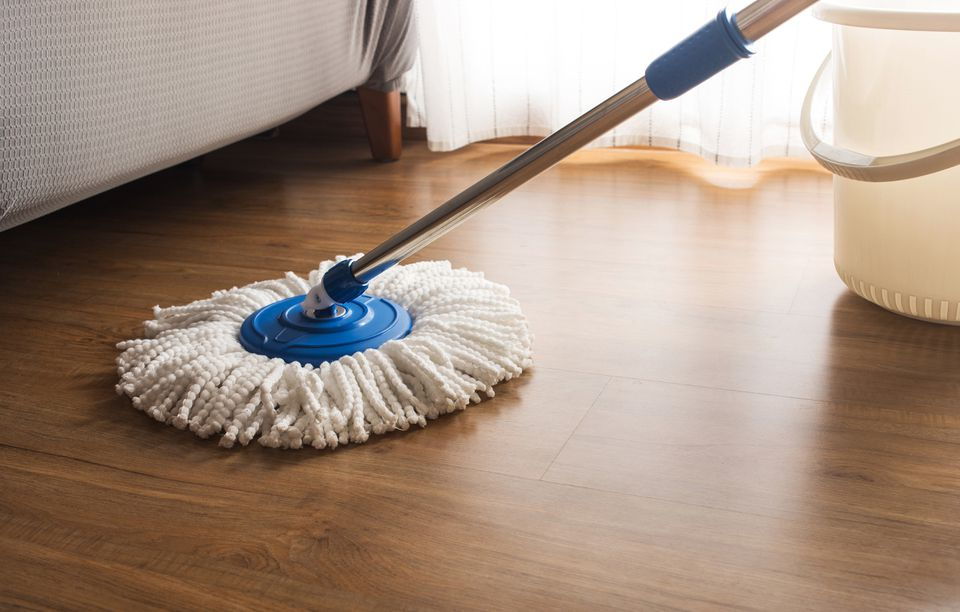 a microfiber mop on a wood floor