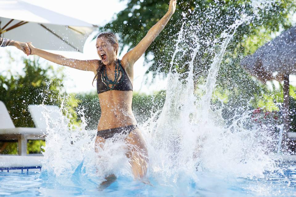 teen girl jumps into pool