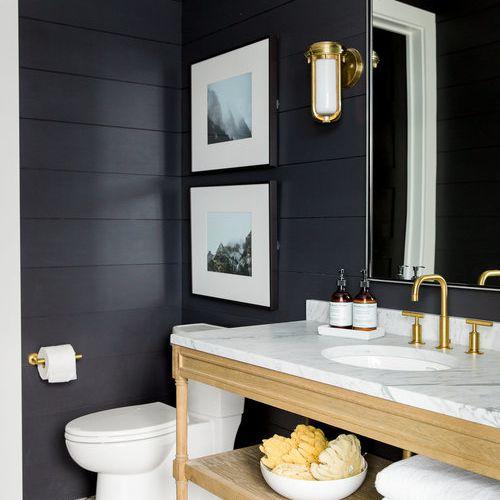 Bathroom with art hanging