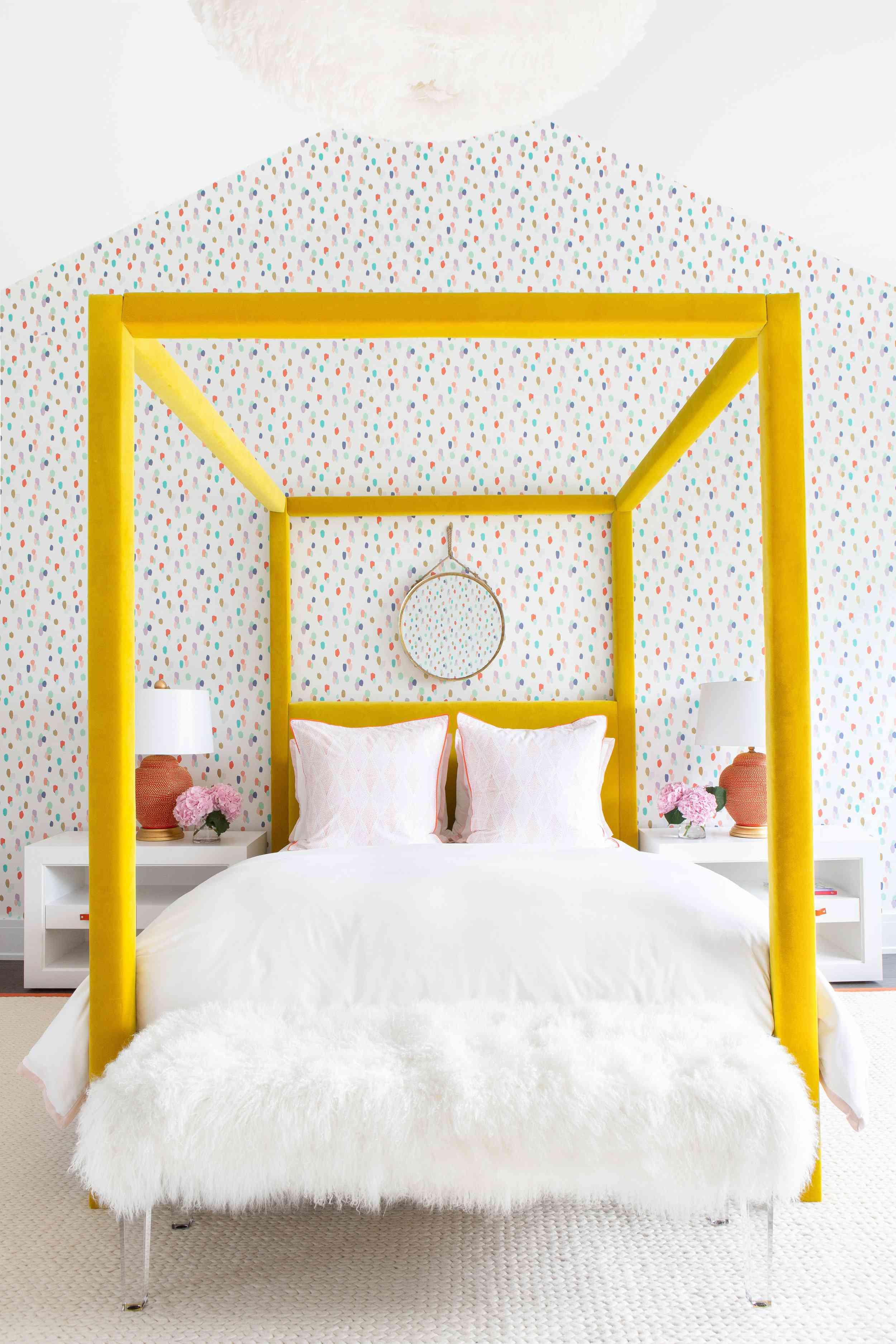 yellow canopy bed in children's bedroom