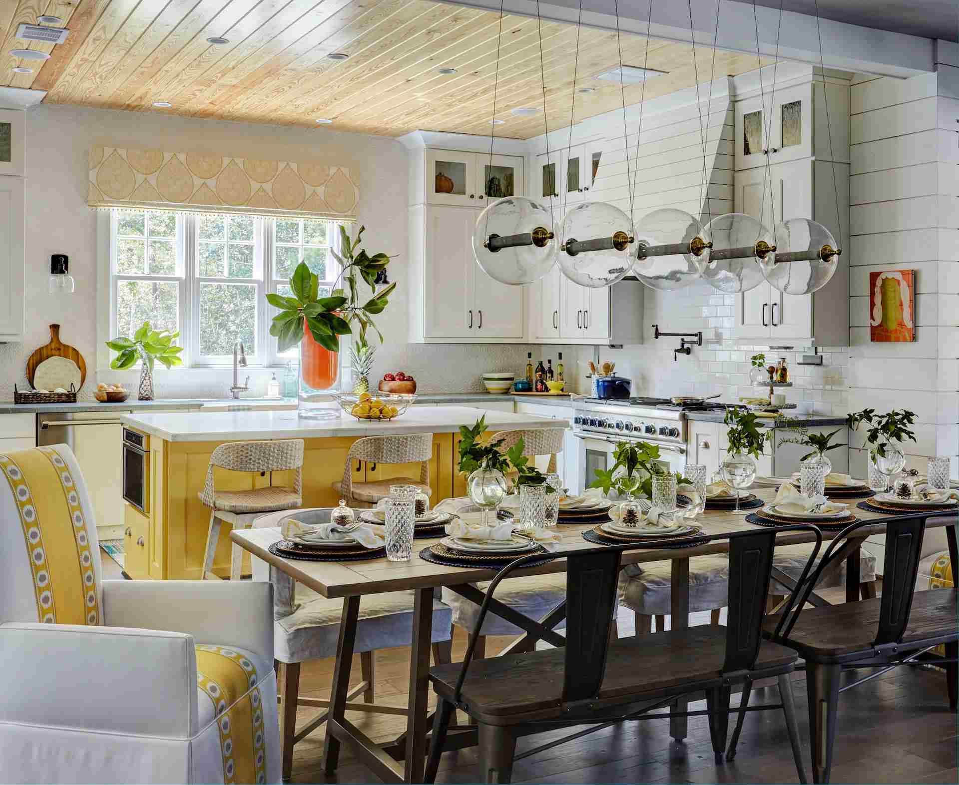 yellow kitchen island in white kitchen