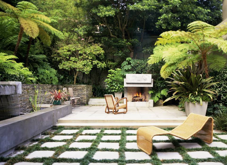 Contemporary tropical patio with landscaping
