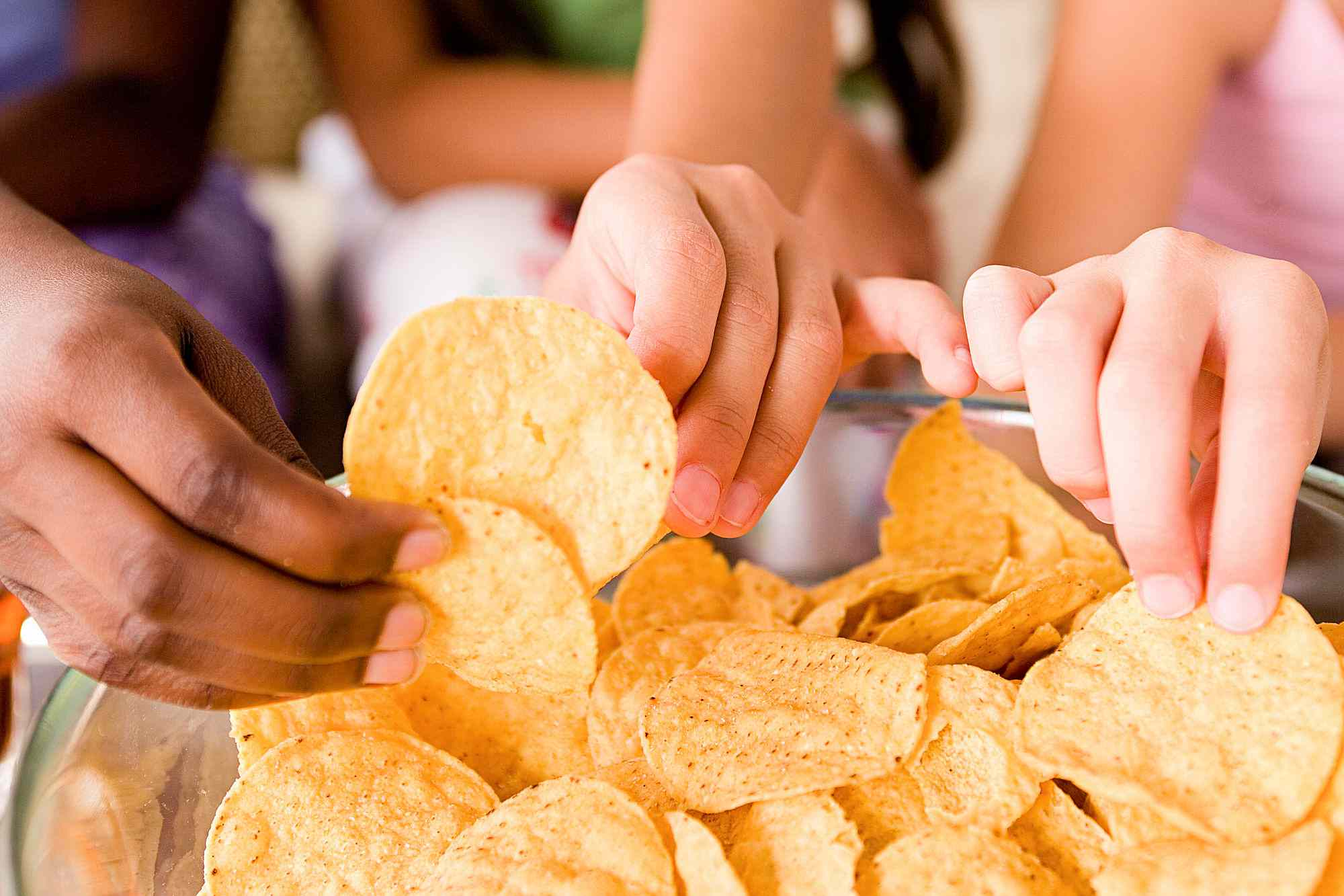 people eating tortilla chips
