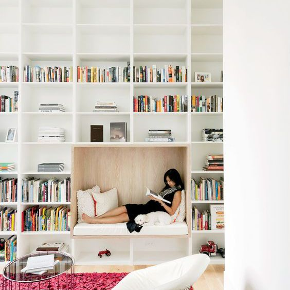 Woman sitting in nook in home office