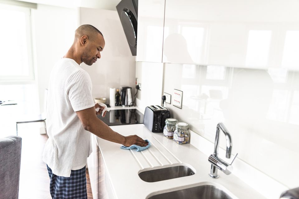Man cleaning counter